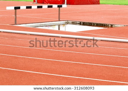 Athlete on track in the stadium, trough race - stock photo