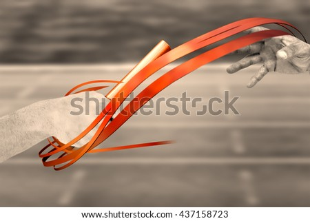 Athlete passing a baton to the partner against race track - stock photo