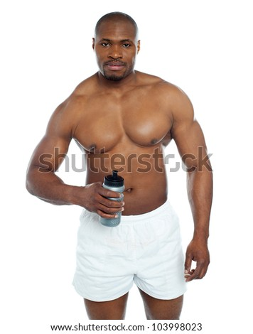 Athlete posing with health drink bottle isolated over white - stock photo