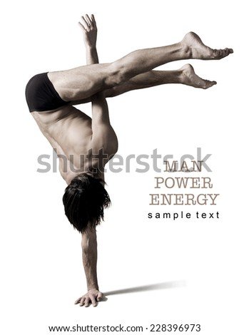 Athlete.Power.Energy.Gym,Athletic male figure on a white background.Circus actor stand on one hand .Sepia. - stock photo