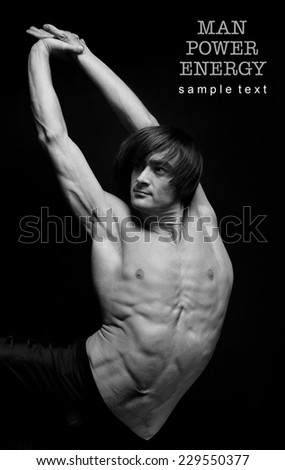 Athlete.Power.Energy.Gym.Men's sports figure on a black background.exercise.Black-and-white image. - stock photo