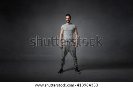 athlete ready for work out. dark background - stock photo