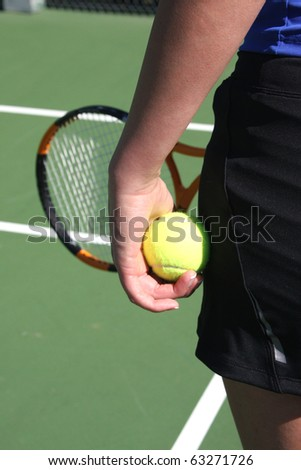 Athlete ready to serve the tennis ball - stock photo