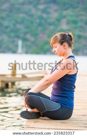 athlete regain strength in the lotus position - stock photo
