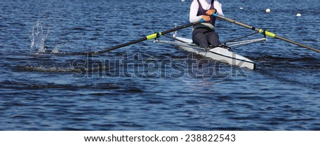 Athlete rower at the start. spray. - stock photo