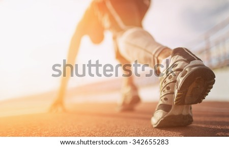 Athlete runner feet running on treadmill closeup on shoe - stock photo
