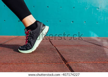 Athlete runner foot, closeup on shoe. - stock photo