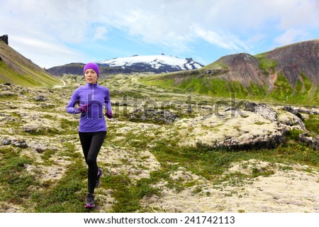 Athlete trail runner - running woman exercising. Fit female sport fitness model training jogging outdoors living healthy lifestyle in beautiful mountain nature, Snaefellsjokull, Snaefellsnes, Iceland. - stock photo