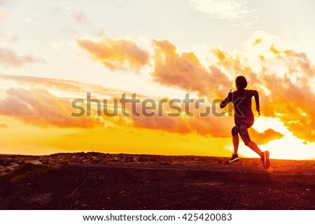 Athlete trail running silhouette of a woman runner at sunset sunrise. Cardio fitness training for marathon race. Active healthy lifestyle in summer nature outdoors. Goal achievement challenge concept. - stock photo
