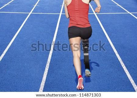 athlete with handicap on race track - stock photo