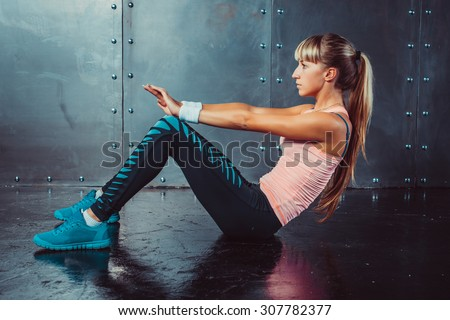 Athlete woman doing abdominal crunches exercise Side view concept fitness sport training - stock photo