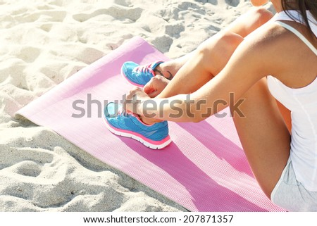 athlete woman preparing for her running workout. - stock photo