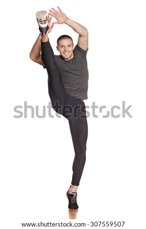 athletes doing exercises for stretching in the studio - stock photo