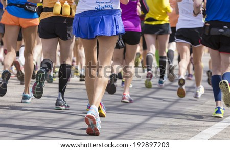 Athletes heading fast and steadily to the finishing line during a marathon in the USA. - stock photo
