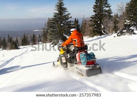 Athletes on a snowmobile. - stock photo