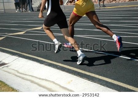 Athletes racing - stock photo