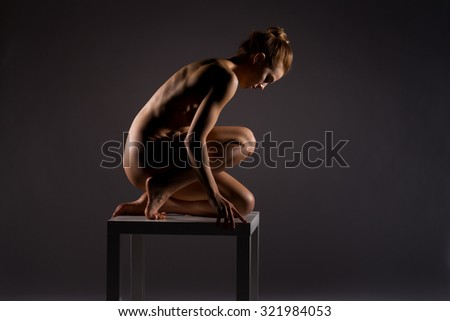 Athletic body of young woman over dark background. Fitness concept. - stock photo