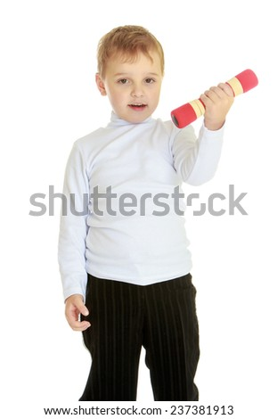 Athletic development, fitness and sports for children concept.Little boy with dumbbells in his hands. - stock photo