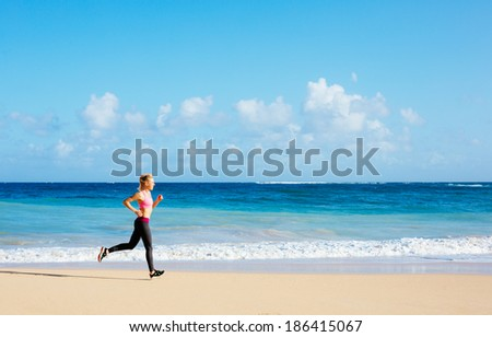 Athletic Fitness Woman Running on the Beach. Female Runner Jogging. Outdoor Workout. Fitness Concept. - stock photo