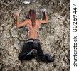 Athletic girl climbing on rock-climbing wall - stock photo