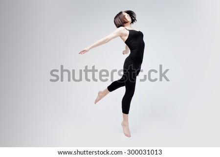 athletic girl posing in Studio, place for your text on the right - stock photo