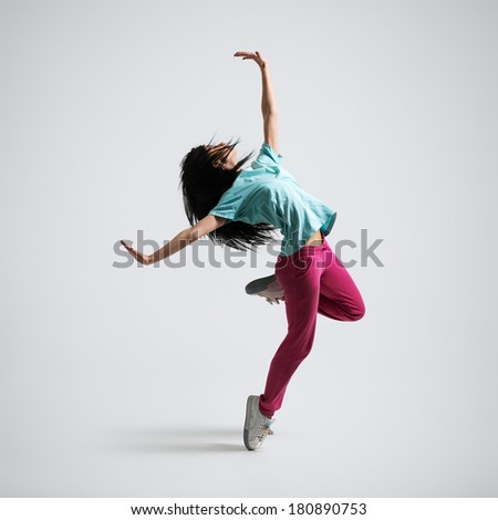 athletic girl standing on his haunches and waving his arms - stock photo