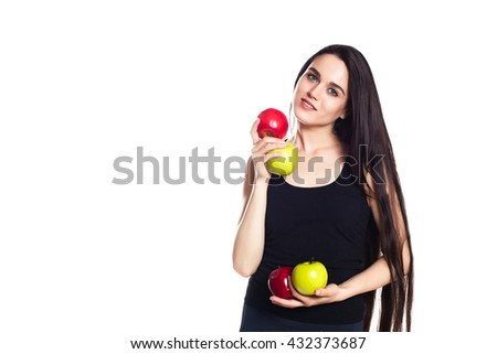 athletic girl with apples.  Portrait of beautiful caucasian sporty woman. Young athlete smiling, holding apple and looking at camera. Isolated on white background - stock photo