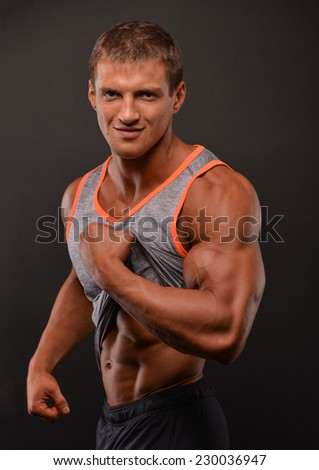 Athletic male model in t shirt - stock photo