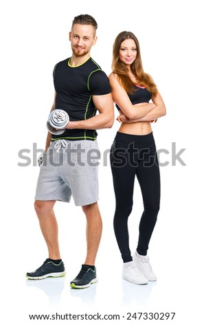 Athletic man and woman with dumbbells on the white background - stock photo