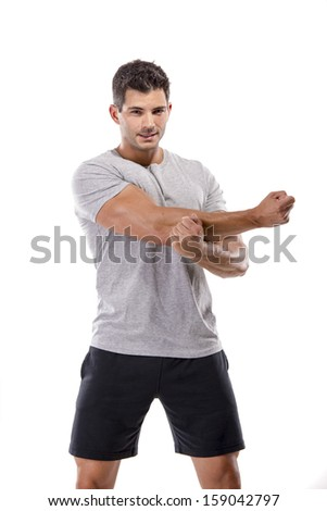Athletic man doing some warming exercises, isolated over a white background - stock photo