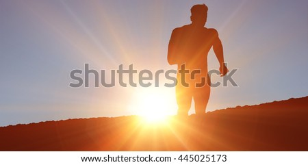 Athletic man jogging against white background against clouds - stock photo