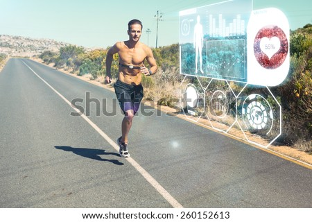 Athletic man jogging on open road with monitor around chest against fitness interface - stock photo