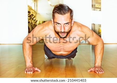 Athletic man making push ups - stock photo