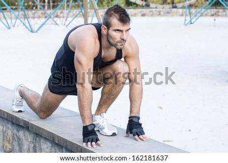 Athletic man preparing to the run. - stock photo