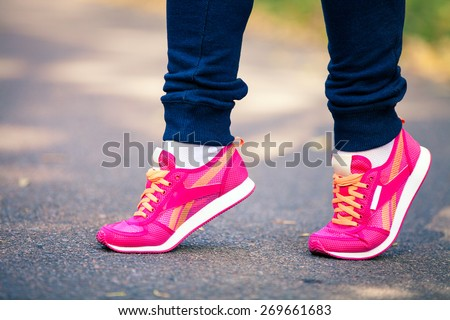 athletic pair of feet on a grass - stock photo