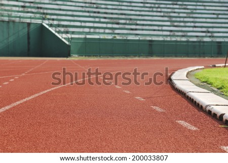 Athletic running track in stadium - stock photo
