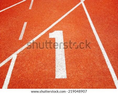 Athletic running track with number one - stock photo