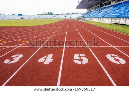 Athletic running track with number three, four,five and six in stadium - stock photo