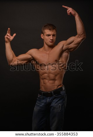 athletic shirtless male model flexing muscles - stock photo
