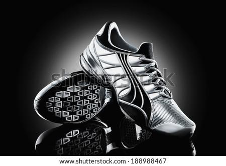 Athletic shoe on black background - stock photo