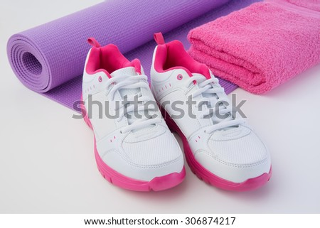 Athletic shoes and mat after workout sweat - stock photo