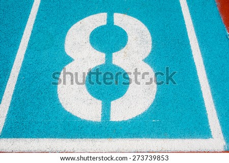 Athletic Surface Markings -- Number eight -- in bright colors, using - stock photo