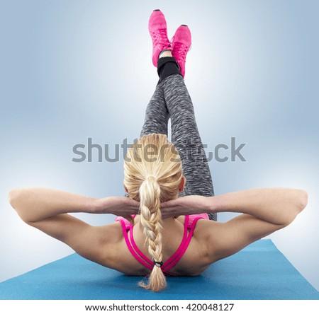 Athletic woman doing pilates exercises  - stock photo