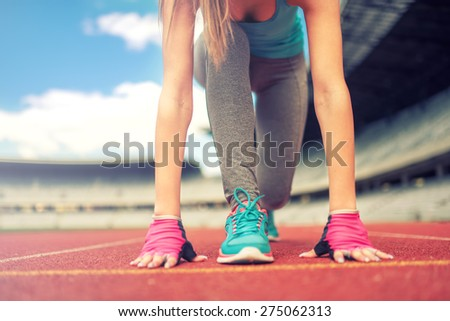 Athletic woman going for a jog or run at running track. Healthy fitness concept with active lifestyle. Vintage, retro, instagram filter  - stock photo