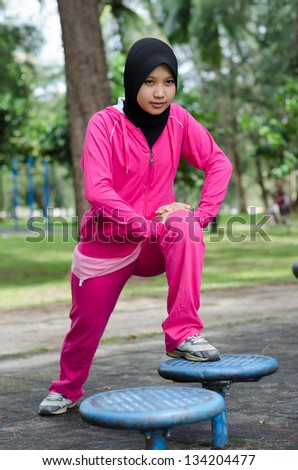 Athletic woman warming up before her morning workout. healthy lifestyle concept. - stock photo