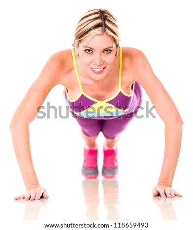 Athletic woman working out doing push-ups isolated over white - stock photo