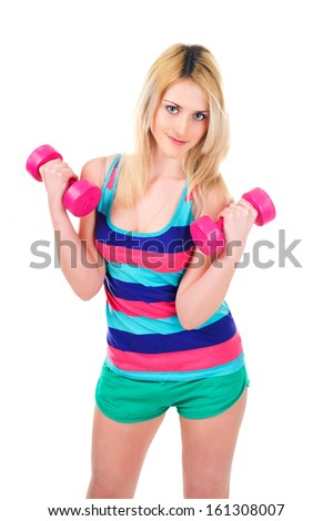 Athletic young girl in bright shirt with dumbbells isolated on white  - stock photo