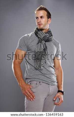 Athletic young male in grays - stock photo