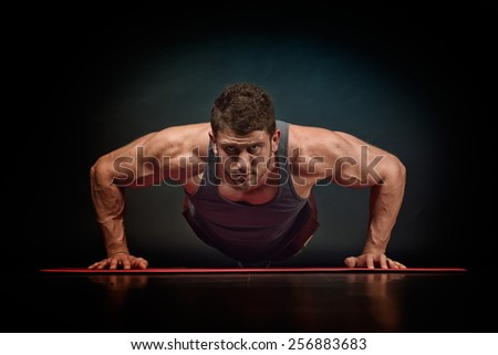 athletic young man exercising - stock photo