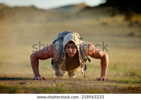 athletic young man exercising outdoor - stock photo
